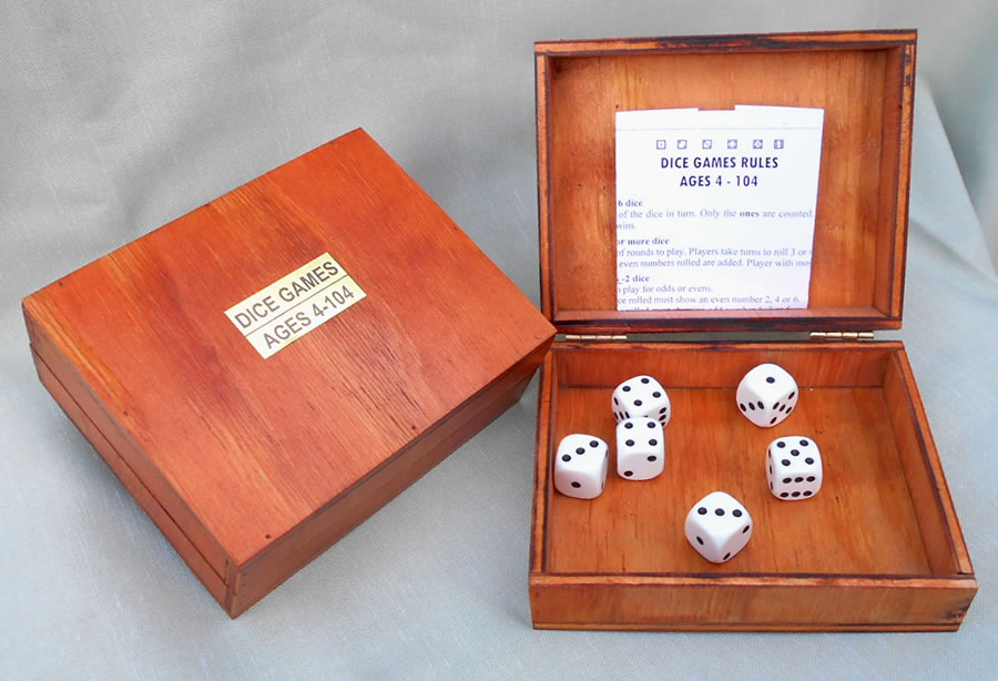6x16mm White Spot Dice in wood box. Rules for 8 Games. Links for more games.